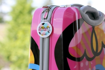 DOTS ON PINK SUITCASE