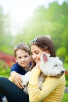 Happy siblings and their dog